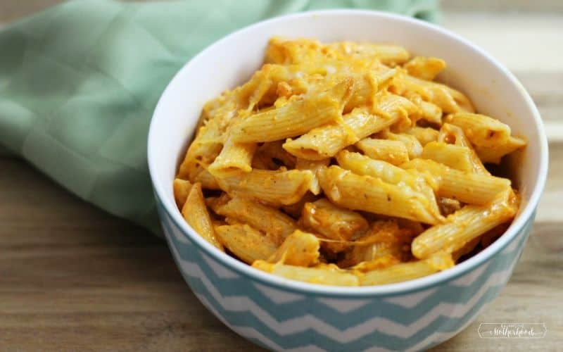 buffalo chicken pasta in bowl with napkin