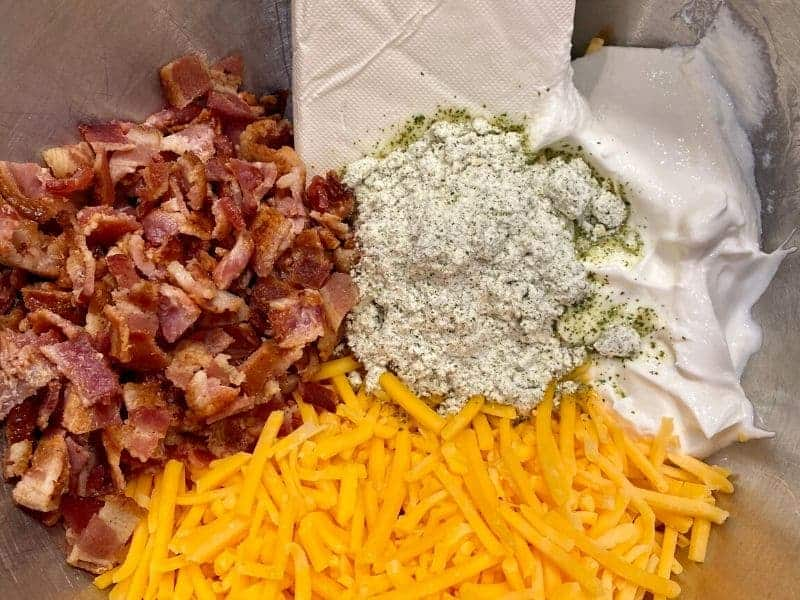 cream cheese, sour cream, cheddar cheese, bacon, and ranch seasoning in metal bowl
