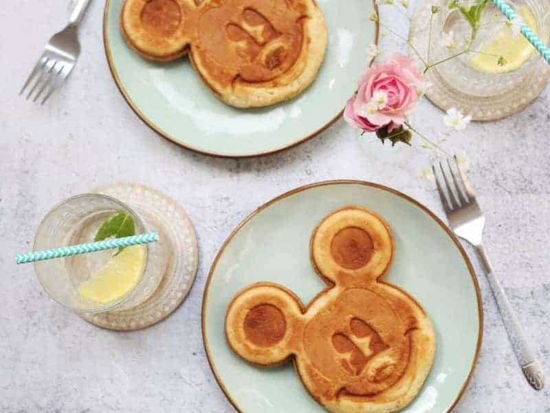 two Mickey Mouse pancakes and drinks