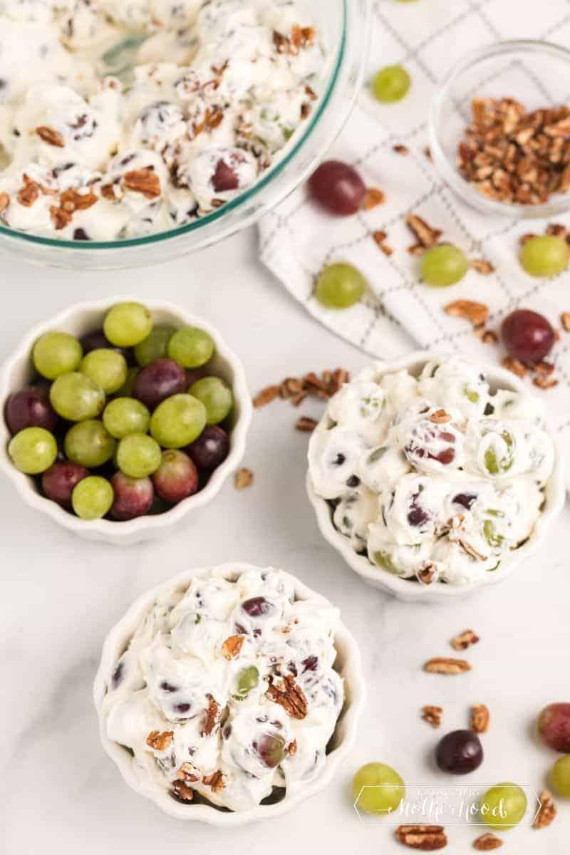 bowl of grapes next to bowls of grape salad