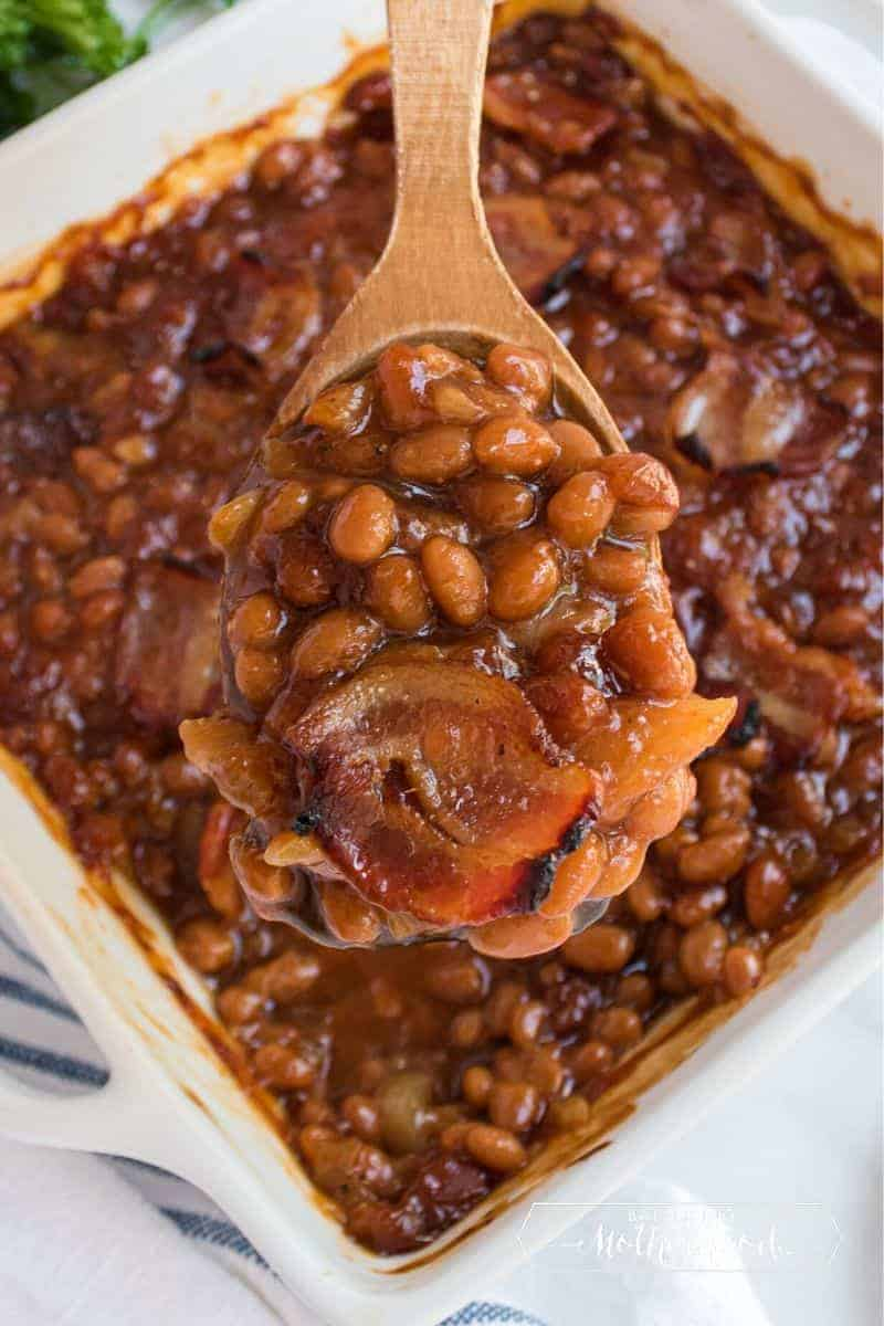 Baked beans on wooden spoon
