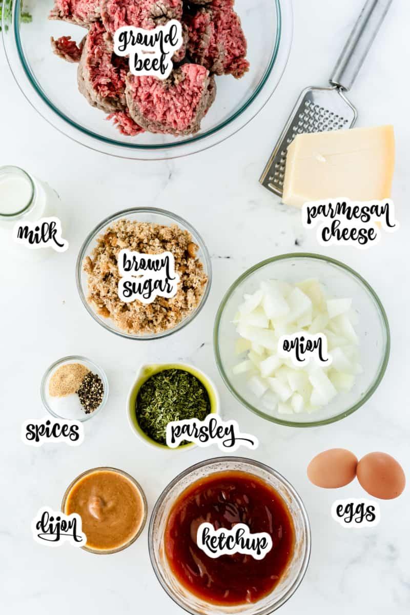 meatloaf ingredients: milk, ground beef, parmesan cheese, onion, parsley, garlic powder, parsley, eggs, ketchup, dijon