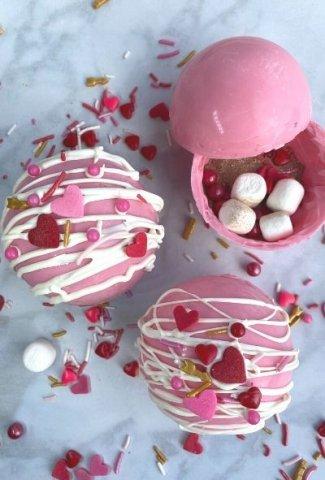 three pink hot chocolate bombs