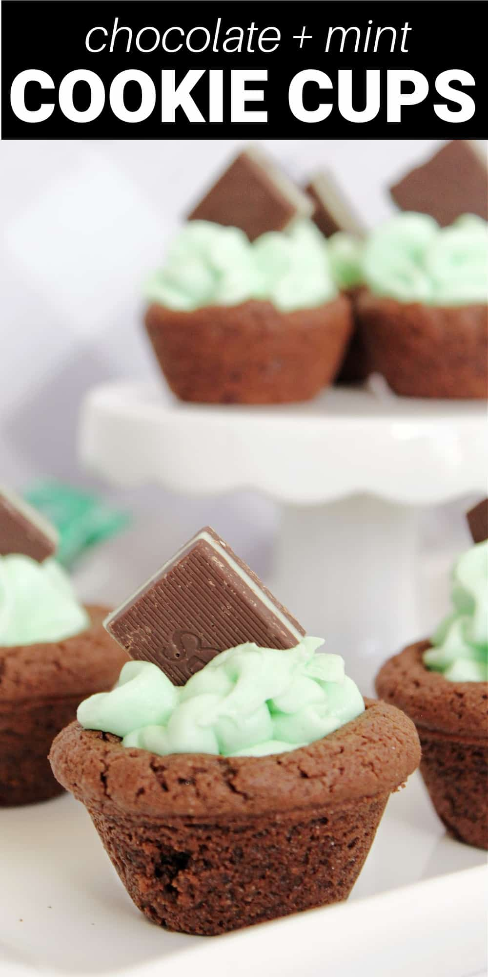 Chocolate mint cookie cups are a simple chocolate cookie dough pressed into a mini-muffin pan making a hole to fill with creamy mint buttercream frosting. Topped with an Andes mint, these are a cute chocolate mint dessert.