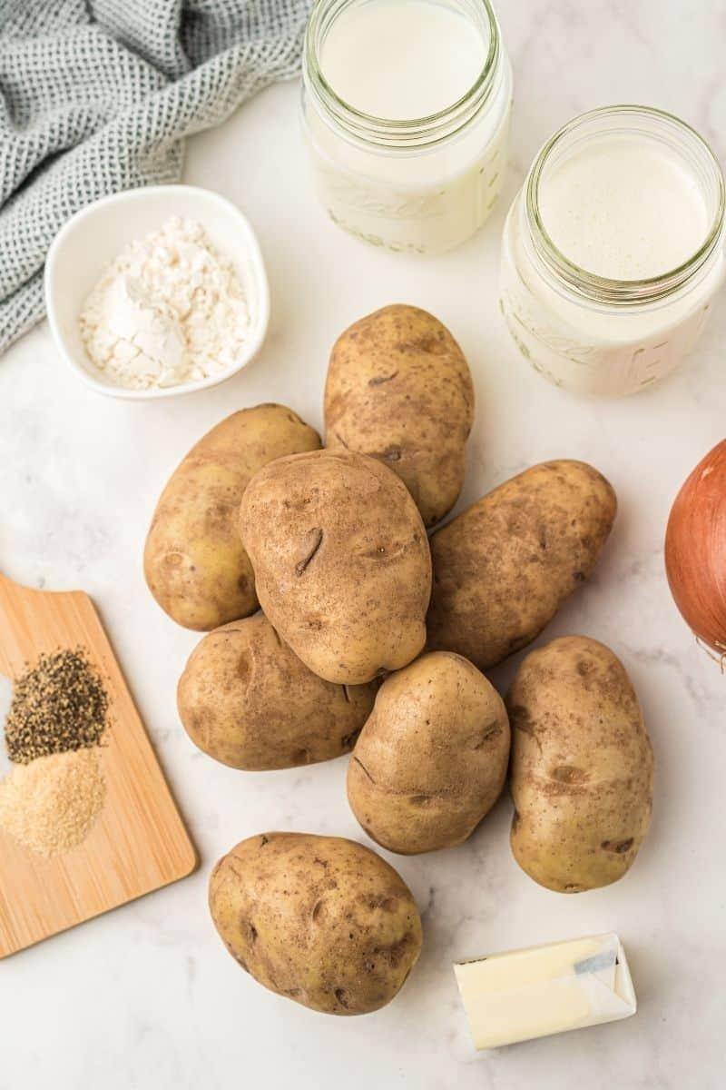 ingredients: milk, cream, potatoes, onion, salt, pepper, garlic powder, flour