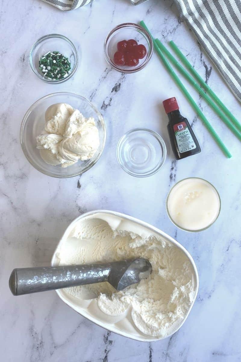 shamrock shake ingredients: green sprinkles, maraschino cherries, green food coloring, milk, vanilla ice cream, mint extract