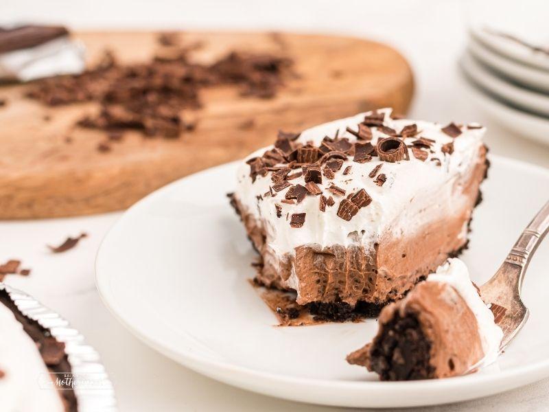slice of chocolate cream pie with bite removed