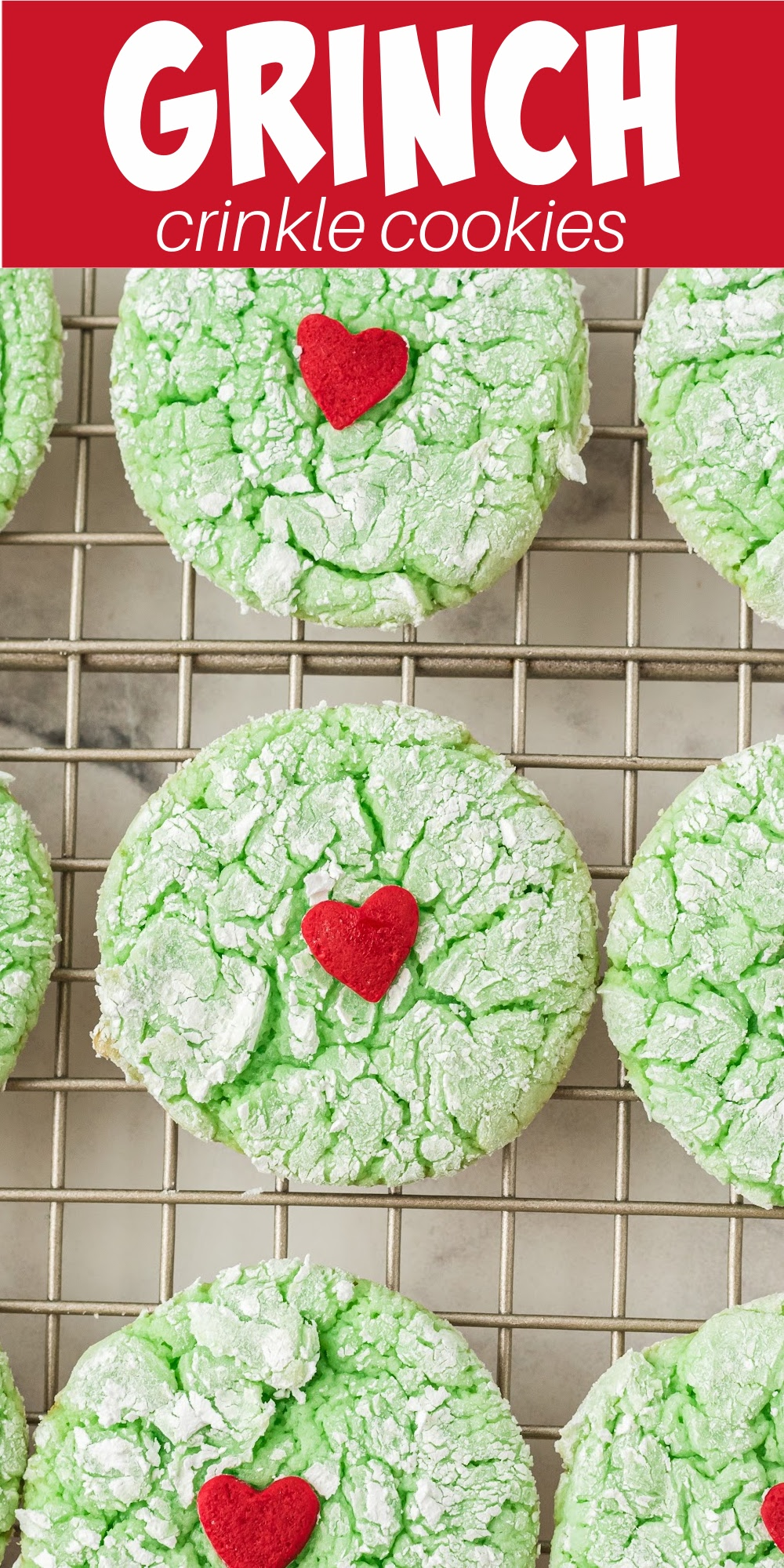 Grinch crinkle cookies are an easy cake mix cookie that's soft and delicious! These fun treats have a huge red sprinkle in the center of the soft cookie that kids and adults love.