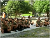 Soldiers of the 40th Infantry Battalion sit down on the basketball court to watch the International Day of Peace Program.