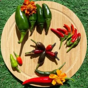 Chillies on a wooden plate with flowers