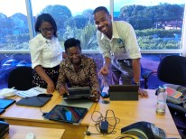 Abi-Gaye and Luwayne examining the application with Ms. Blackwood from STATIN