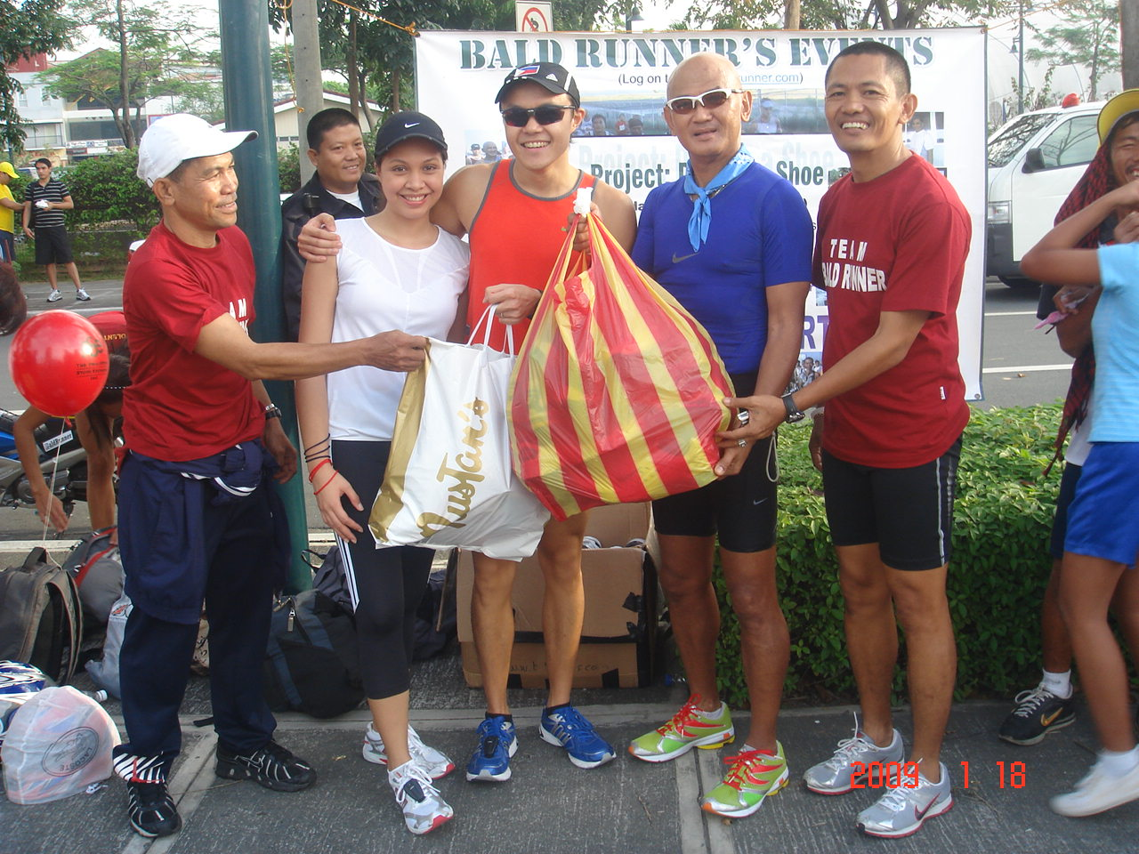 Jael & Cookie Wenceslao Turning-Over Bags Full of Running Shoes