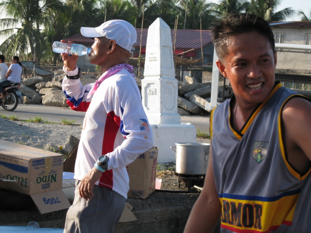 Lots of Water To Drink at Km #50 & the Smiling Capt Quilo