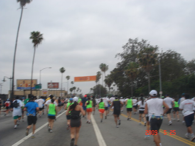 Mile Marker/Banner On Top Of The Runners