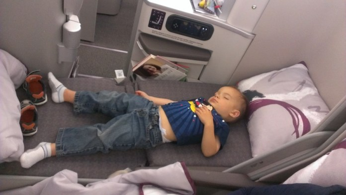 Timmy in lay flat business class seat
