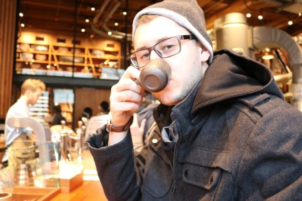 Tyler sipping coffee