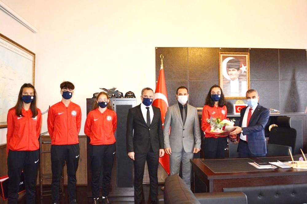Milli sporcular Kaymakam Atasoy'u ziyaret etti