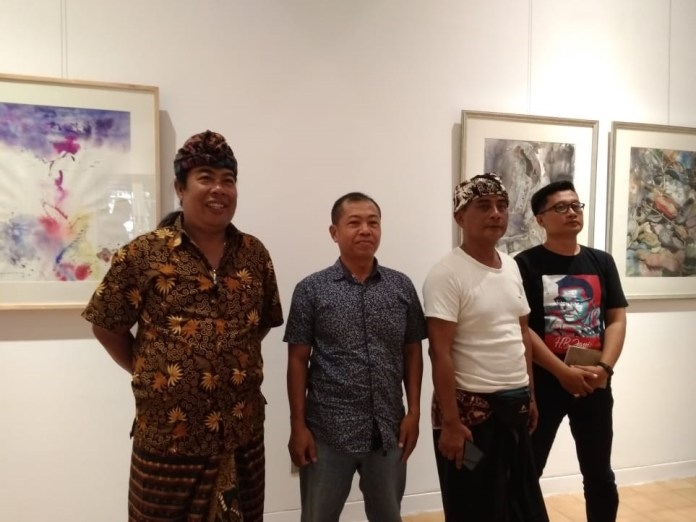 Left to right: Made Dollar Astawa, Nur Ilham, Made Mahendra Mangku, and Wayan Seriyoga Parta at the exhibition's press conference, on Thursday.