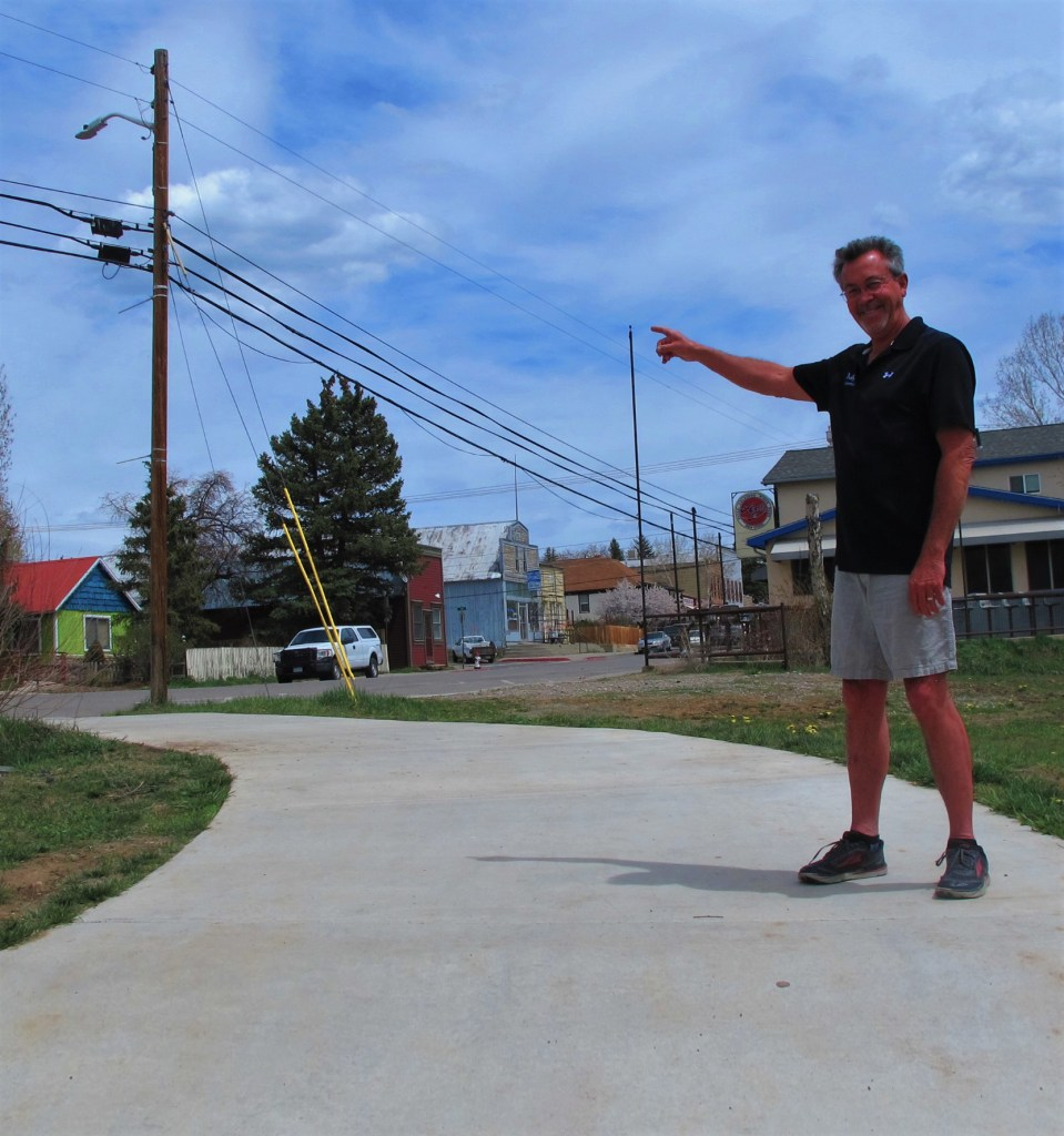 Dan McClure points to a telephone pole