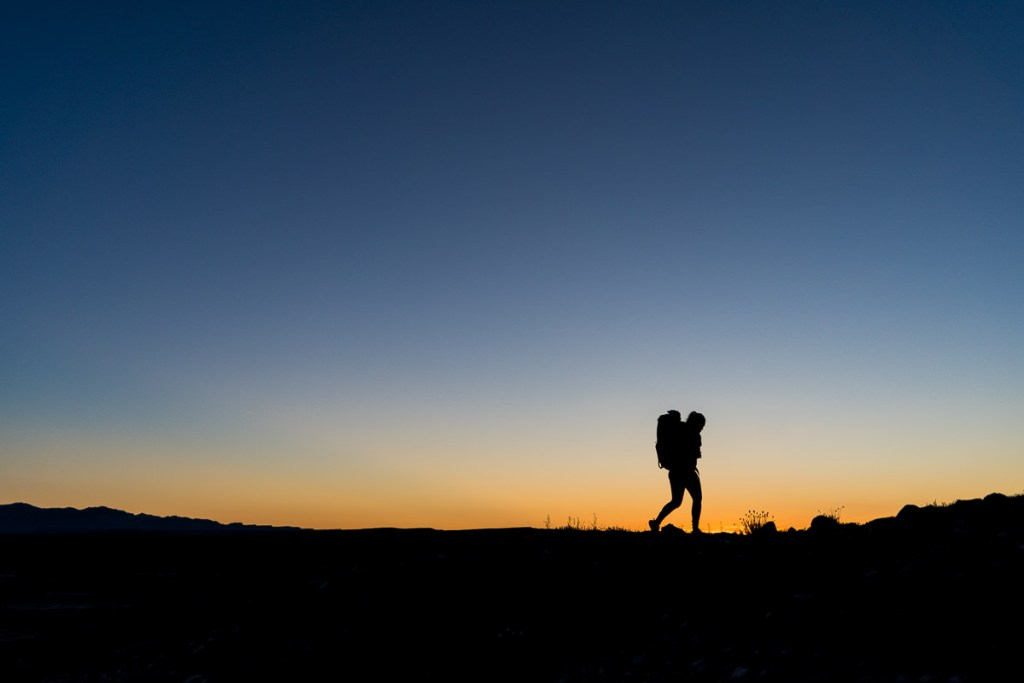 sunrise hike silhouette utah road trip
