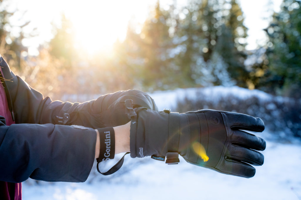 gordini polar glove strap putting on