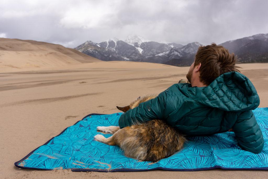 rugged tarpestry man dog lounging