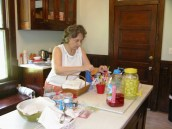 Grandma setting up drink station in kitchen at Ballentine-Spence House