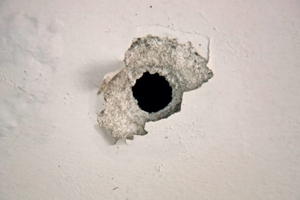 Bullet hole in teen