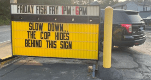 Cop hides behind this sign