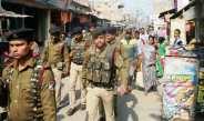 सहतवार में पुलिस व आरपीएसएफ जवानों का फ्लैग मार्च