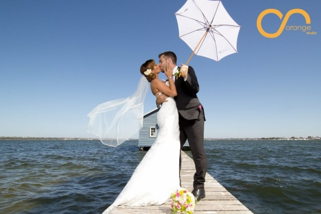 Alex and Shazzy Posing On Their Wedding Day at Matildas on the Swan River, Perth, WA