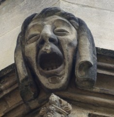 a grotesque face on the oriel window of the Master's Drawing Room (front quad, near st 7)