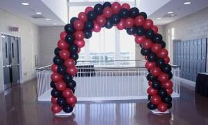 Garnet and black spiral balloon arch, by Balloonopolis, Columbia, SC