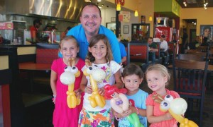 Shawn and kids with balloon animals at Moe's restaurant, by Balloonopolis, Columbia, SC