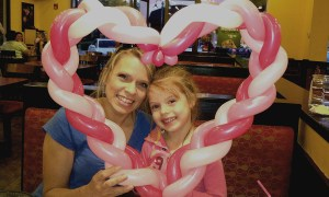 Mom and daughter with heart balloon at Moe's restaurant, by Balloonopolis, Columbia, SC