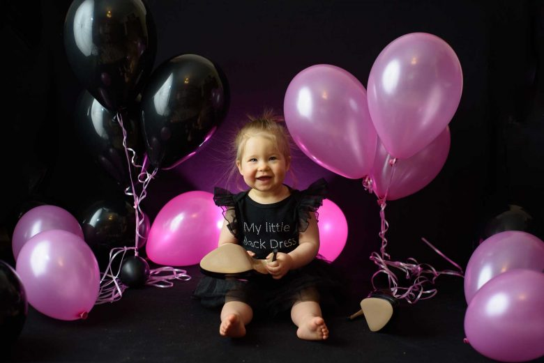 Cute Little Girl Photo-shoot with Black and Pink Latex Balloons