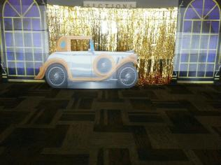 Car in front of gold shimmer curtain