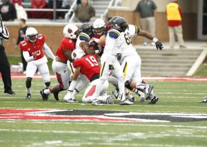 Three Ball State defenders in to make the tackle