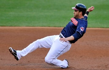 Apr 24, 2012; Cleveland, OH, USA; Cleveland Indians second baseman Jason Kipnis (22) slides in to third base in the first inning against the Kansas City Royals at Progressive Field. Mandatory Credit: David Richard-US PRESSWIRE