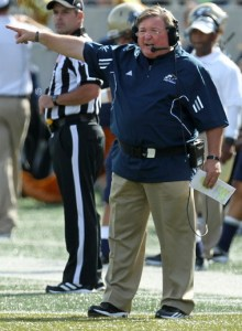 Akron head football coach Terry Bowden signals to his offense .