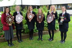 Ballyclare High's Athletics' Captains with the team trophies won at Nebssa and District level.
