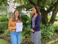 Amy McGookin former Head Girl celebrates with Dr Rainey on achieving an A star grade and 2 A grades at A level.