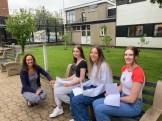 Dr Rainey congratulates Ballyclare High pupils Megan Stewart, Molly Scott and Rebecca McKenzie on achieving 4 A grades at A2 level.
