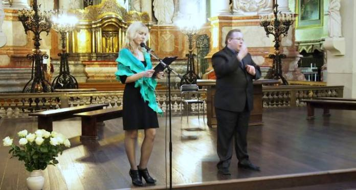 Shown here is Lithuanian journalist Gitana Merkeliene during the reading of her poems at St. John's Church in Vilnius. Standing next to Gitana on the right is Arunas Saukecas, sign language interpreter (translator) at the event. In addition, Gitana read the poetry selected by Edmondas Atkociunas, as well. Photo by Marija Markina
