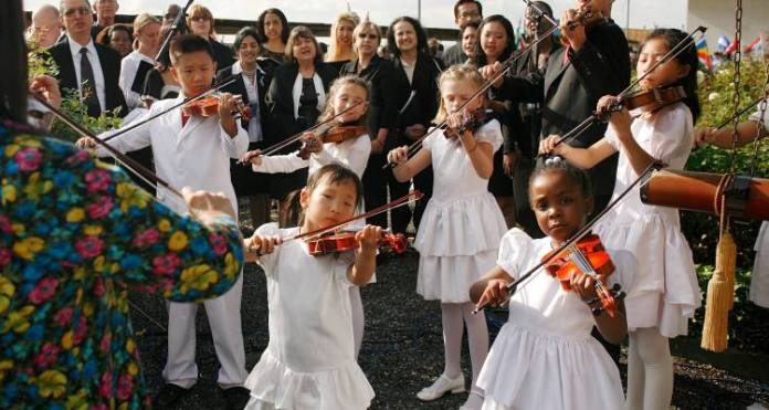 It is a tradition to ring the UN Peace Bell twice a year at UN Headquarters, once on the March equinox (March 20-21) , and a second time on the International Day of Peace (September 21). Shown here are the young Tarumi Violinists, under the direction of Yukako Tarumi, playing on the International Day of Peace on September 21, 2010. UN Photo/Rick Bajornas