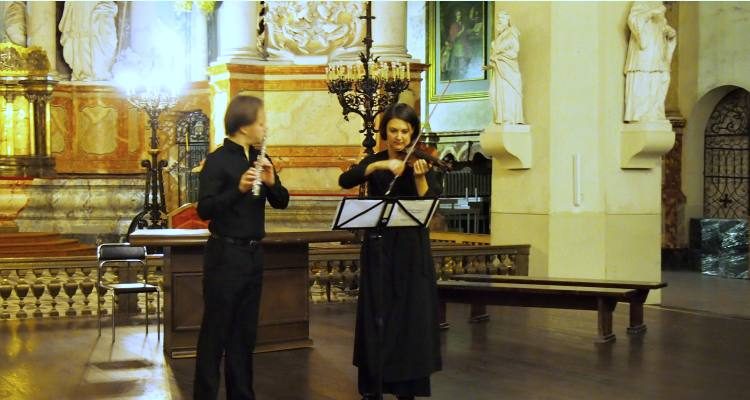 Shown is Vytautas Oskinis (flute) performing with Diemante Merkeviciute (violin) at St. John's Church in the Old Town of Vilnius. Photo: Marija Markina.
