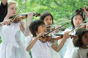 Shown here is a group of talented Tarumi Violinists performing at the UN Peace Bell on May 6, 2015 at UN Headquarters in New York . A special ceremony was organized by the Permanent Mission of Japan to the United Nations in collaboration with the Department of Public Information to commemorate the return of the Peace Bell from the Rose Garden to its original location in the Japanese Garden. UN Photo/Mark Garten