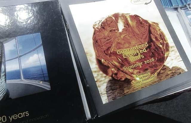 """Shown here next to the book entitled """"VIA HANSA – 20 years – Service, sustainability, and innovation"""" is a Baltic vision brochure on """"Guaranteed Escorted Tours Summer 2016."""" Photo: Ann Charles"""