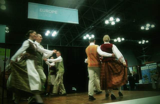 """Shown here folk dancing on the Europe cultural stage at The 2016 New York Times Travel Show too was """"Viesulas"""" or Whirlwind from New Jersey. Their performance was presented on stage by the Office of the Consulate General of the Republic of Lithuania in New York under Julius Pranevičius, Lithuanian Consul General, in cooperation with Via Hansa Tours. Photo: Ann Charles"""