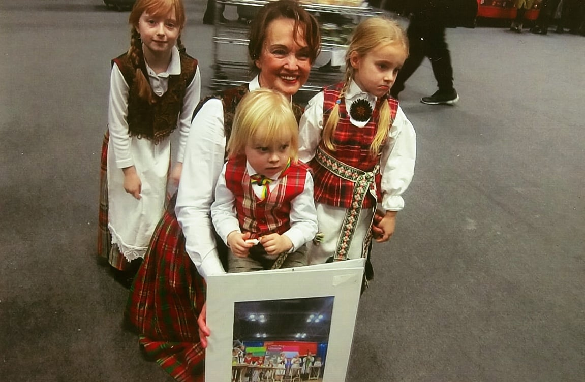 "Pictured at The 2016 New York Times Travel Show is director Violeta Kundrotienė, with Nora Farwell next to her on the left, and two other young performers from the Lithuanian children's group ""Spindulėlis"" (Little Sun Rays) following a cultural performance at the Jacob K. Javits Convention Center during The 2016 New York Times Travel Show. Photo: Ann Charles"